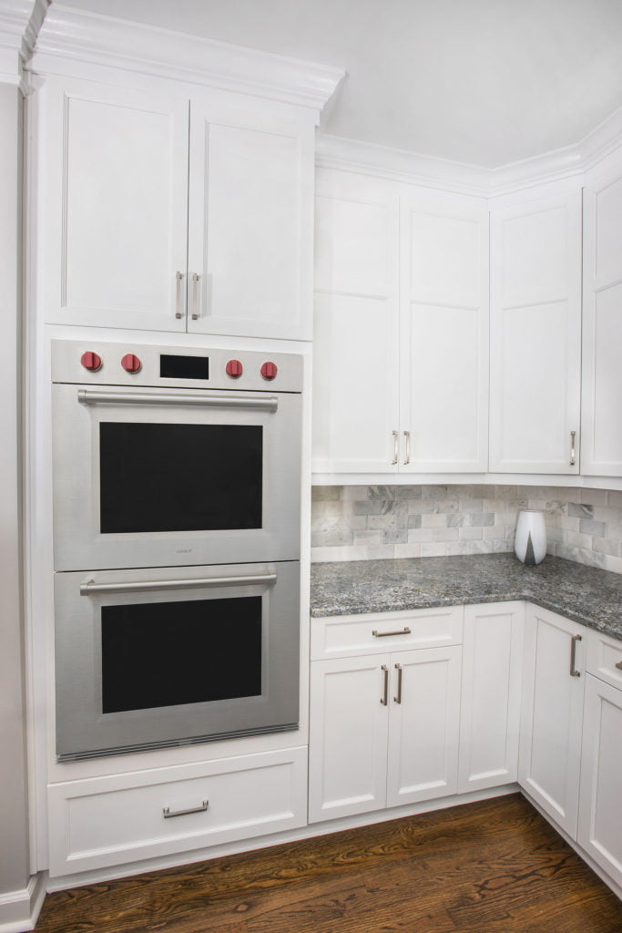custom kitchen remodel with stove built into the cabinetry