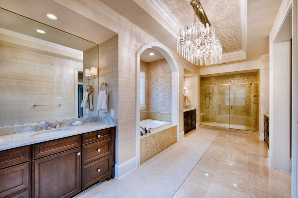 bathroom remodel with large vanity, walk in glass door shower and bathtub