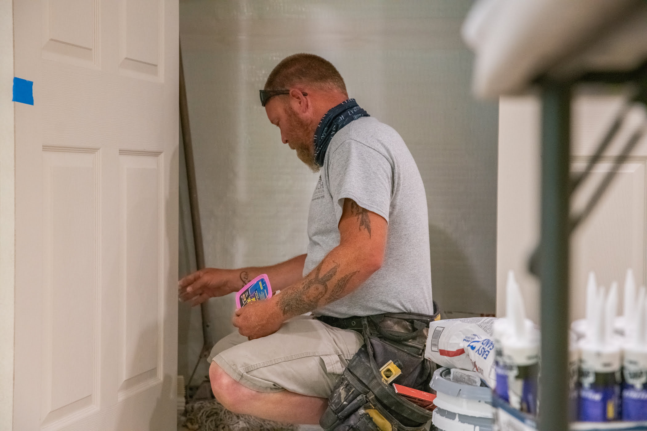 Lynch employee working on paint finishes on a Lynch home remodel project