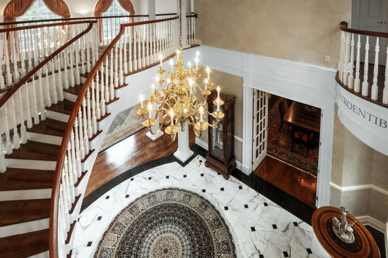 grand foyer remodel with spiral staircase