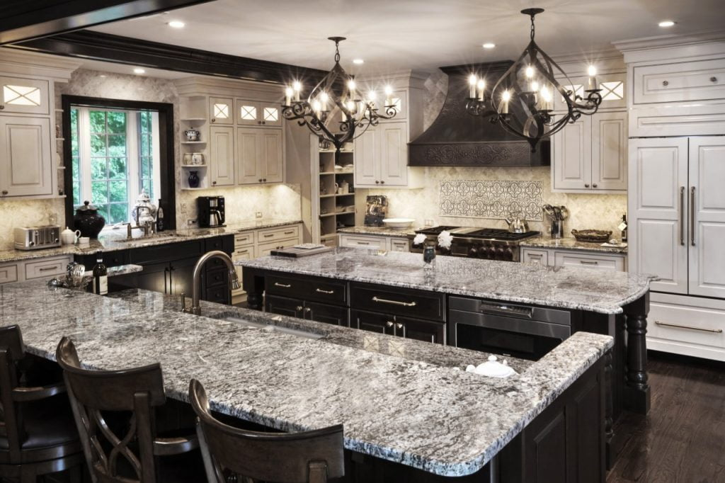 kitchen remodel with double chandelier, large kitchen island and granite countertops